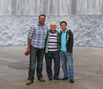 Novice Juan Carlos Castaneda Rojas, Fr. John Czyzynski (novice master) and James Nguyen at the Gerald D. Hines Waterwall Park in Houston