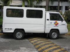 Note the logo on the van door