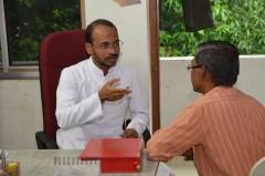 Fr. Agi meets with a parishioner