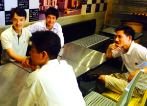 Some of Fr. Tom's students out for a final pizza night with their teacher.