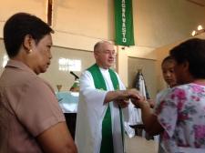 Fr. Steve shares communion