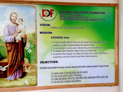 A sign describing the Kasanag Daughters Foundation