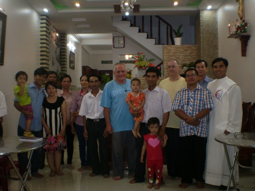 Family and SCJs after the house blessing.