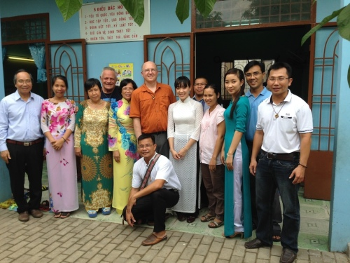Fr. Rino and Fr. Steve with school staff