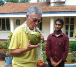 Fr. Tom tries a bit of coconut milk