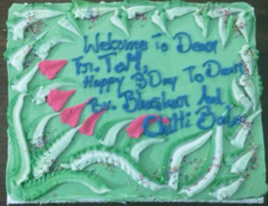 "The ""welcome"" wishes came on Fr. Tom's last night with the community, but cake is good no matter when it is served!"