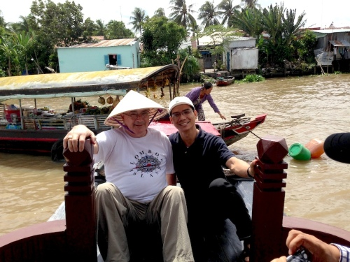 Fr. Wayne and Trung on the Mekong Riover