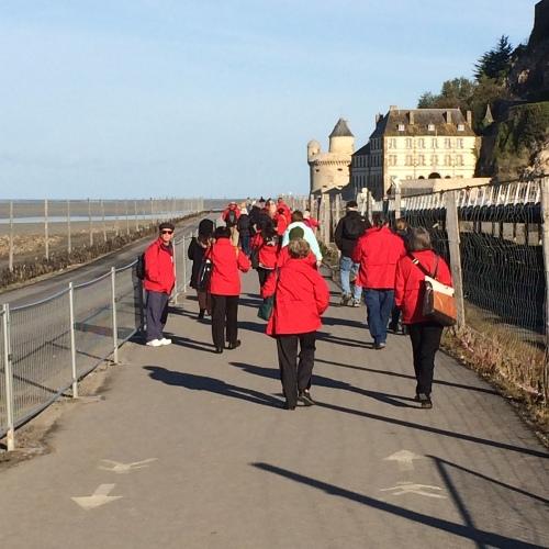 Pilgrims walk toward St. Michael
