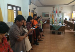 Teachers at Yos Sudarso pray at the start of the school day