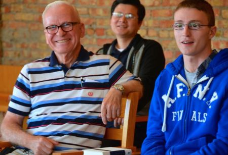 Fr. John (left) smiling during  a community meeting with the Dehon Formation Community in Chicago last fall. The retired novice master has served in formation during most of his 51 years of priesthood.