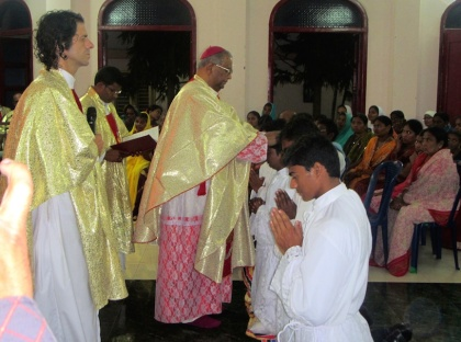 Bishop Gali Bali lays hands on each of those to be ordained.