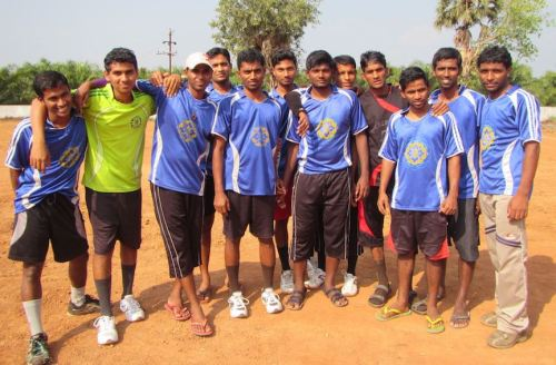 Indian students take a break from their soccer game.