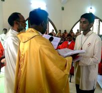Fr. Thomas Vinod presents Br. Siddela Jesuprasad (Jesu) with his cassock.