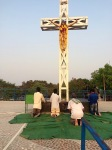 Pray before cross