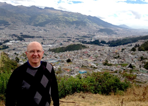 "Fr. Steve with Quito in the background. He describes the backdrop as ""our parish."" Santa María de la Argelia consists of nine chapels that serve over 50,000 people"