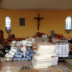 Mattresses and other relief supplies fill the church