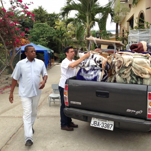 Fr. Bruno and Fr. Jose Luis pack a truck of relief supplies.