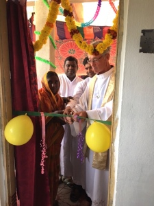 Br. Thambi's mother, Fr. Suresh, Fr. Michael Augustine and Fr. Tom cutting the ribbon for the new house.